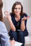 Helpless woman at therapy Stock Photo