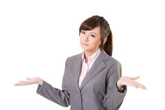 Helpless. Young business woman shrugs her shoulders on white background Royalty Free Stock Photos
