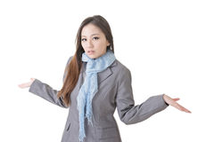 Helpless young business woman. Shrugs her shoulders on white background Royalty Free Stock Images