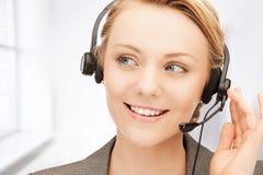 Helpline. Bright picture of friendly female helpline operator stock photos