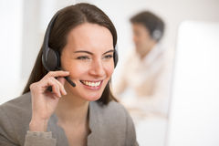 Helpline operator with computer in office, headset Royalty Free Stock Photo