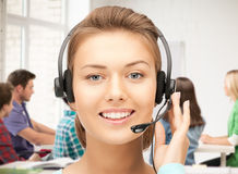 Helpline operator with headphones Stock Photography