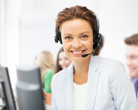 Helpline operator with headphones in call centre Royalty Free Stock Images