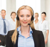 Helpline operator with headphones in call centre Stock Photography