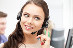 Helpline operator with headphones in call centre Royalty Free Stock Photography