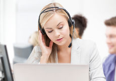 Helpline operator with headphones in call centre Royalty Free Stock Image