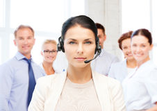 Helpline operator with headphones in call centre Stock Photos