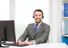 Helpline operator with headphones and computer Royalty Free Stock Photos