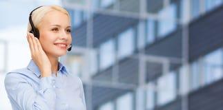 Helpline operator in headset over business center Stock Photos