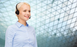 Helpline operator in headset over grid background Royalty Free Stock Photography