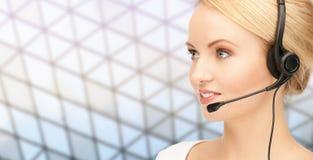 Helpline operator in headset over grid background Stock Photo
