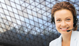 Helpline operator in headset over grid background Royalty Free Stock Images
