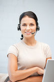 Helpline operator with laptop computer Stock Photo