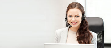 Helpline operator with laptop computer Stock Photo
