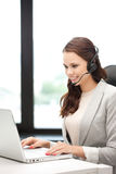 Helpline operator with laptop computer Royalty Free Stock Photos