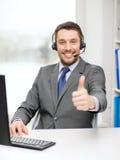 Helpline operator z hełmofonami i komputerem Zdjęcie Royalty Free