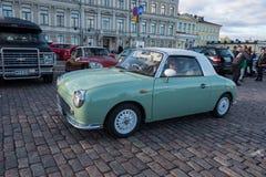 Helsingfors Finland gammal bil Nissan Figaro Royaltyfri Bild