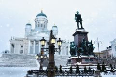 Tuomiokirkko Cathedral with statue of Alexander II in Helsinki, Finland royalty free stock photo