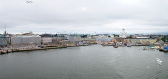 Helsinki aerial panorama. Helsinki, capital of Finland as seen from the Baltic sea with seagulls flying in front royalty free stock images