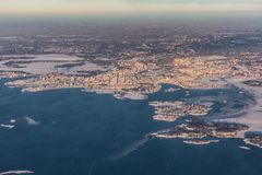 Helsinki, Capital of Finland - aerial view - winter landscape. Helsinki, Capital of Finland - aerial view with Baltic Sea and Islands - winter landscape during stock image