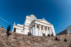 Helsinki Cathedral. Tourists and locals sitting on the steps in front of the Helsinki Cathedral on a sunny day in the autumn Stock Photos