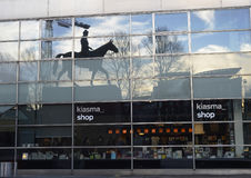 HELSINKI, FINLAND – MARCH 16, 2016: A reflection of the equestrian monument to Mannerheim in the windows of the Museum. Of Contemporary Art Kiasma stock photo