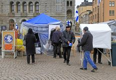 Tents for political agitation on square in center of Helsinki. Helsinki, Finland - April 3, 2017: tents for political agitation on square in center of Helsinki stock photo