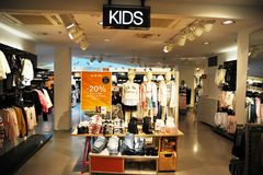 Clothing store with clothes for children in Helsinki stock image