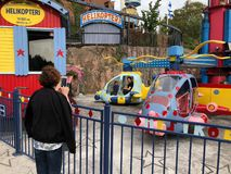 HELSINKI, FINLAND - AUGUST 23, 2018: Having fun at Amusement Park Linnanmaki in Helsinki, Finland Stock Photos