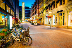 Helsinki, Finland. Bicycles Parked Near Storefronts In Kluuvikatu Street Stock Photo