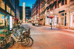 Helsinki, Finland. Bicycles Parked Near Storefronts In Kluuvikatu Street Royalty Free Stock Images