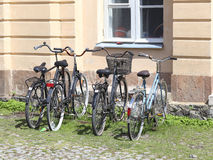 Helsinki, Finland. Bikes on the parking near house Royalty Free Stock Photos