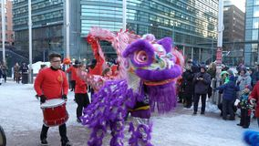 Chinese New Year parade show. Traditional Chinese new year dragons on the streets of Helsinki. HELSINKI, FINLAND - FEBRUARY 15, 2018: Chinese New Year parade