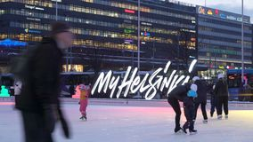 Ice skating rink in Helsinki city centre. stock footage