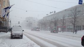 HELSINKI, FINLAND - JANUARY 2012: Snowfall in a city. At winter stock video