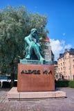 HELSINKI, FINLAND - JULY 17, 2015: Sculpture of Aleksis Kivi on Rautatientori Square. Stock Photography