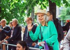 Helsinki, Finland - June 30, 2018: Aged woman on street on Helsinki pride festival royalty free stock photo