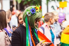 Helsinki, Finland - June 30, 2018: Girl with green hair on street on Helsinki pride festival. Helsinki, Finland - June 30, 2018: Participant with rainbow flag on stock image