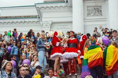 Helsinki, Finland - June 30, 2018: Participants in Santa Claus wearings on stairs of Cathedral on Helsinki pride festival on. Senate square stock photos