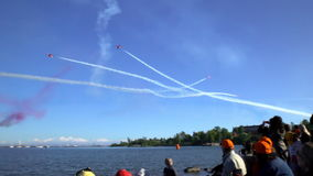 The performance of the aerobatic team the red arrows during the air show. stock video footage