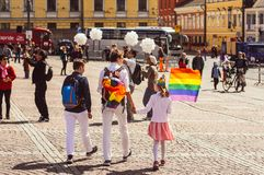 Helsinki, Finland - June 30, 2018: Two women with child with rainbow flag on Helsinki pride festival on Senate square stock image