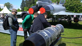 Visitors to the exhibition visiting the new aircraft engine Rolls Royce stock footage