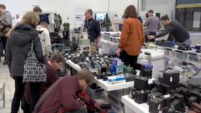 Buyers choosing old vintage cameras at flea market