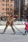 HELSINKI ,FINLAND-MARCH 29 2014:Children skate on an outdoor ice. Rink,HELSINKI ,FINLAND-MARCH 29 2014 Stock Images
