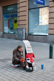 HELSINKI,FINLAND-MARCH 29: the street musician plays on empty bo Stock Image