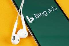 Bing application icon on Apple iPhone X screen close-up. Bing ads app icon. Bing ads is online advertising application. Social med royalty free stock images