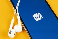 Microsoft Word application icon on Apple iPhone X screen close-up. Microsoft office word icon. Microsoft office on mobile phone. S royalty free stock photography