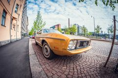 Helsinki, Finland - May 16, 2016: Old car Ford Mustang. distortion perspective fisheye lens royalty free stock images