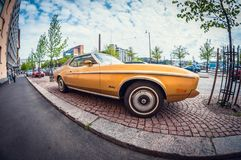 Helsinki, Finland - May 16, 2016: Old car Ford Mustang. distortion perspective fisheye lens royalty free stock photos