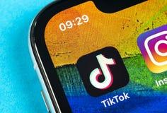 Tik Tok application icon on Apple iPhone X screen close-up. Tik Tok icon. tik tok application. Tiktok Social media network. Social